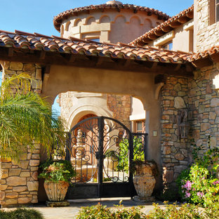 This is an example of a mediterranean entrance in San Diego with a metal front door.