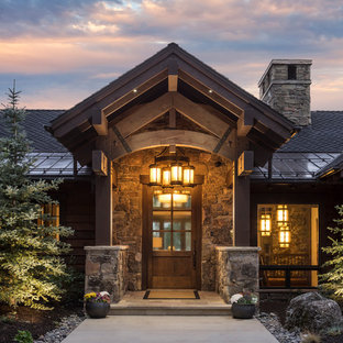 Inspiration for a mid-sized rustic entryway remodel in Salt Lake City with brown walls and a medium wood front door