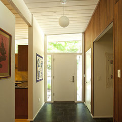 modern entry by Klopf Architecture