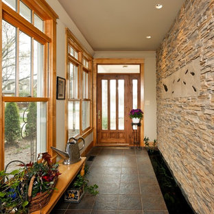 Entryway - small traditional ceramic floor entryway idea in DC Metro with a glass front door and white walls