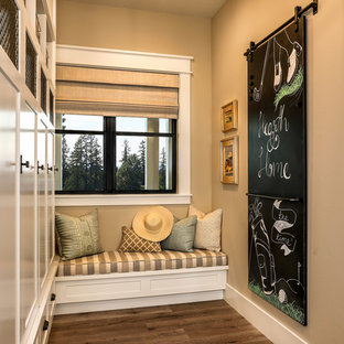 Inspiration for a mid-sized country medium tone wood floor and beige floor entryway remodel in Portland with beige walls and a medium wood front door