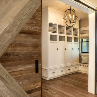Inspiration for a mid-sized farmhouse medium tone wood floor and beige floor entryway remodel in Portland with beige walls and a medium wood front door