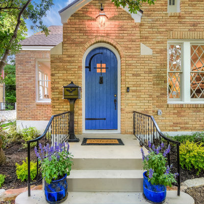 Inspiration for a huge transitional gray floor entryway remodel in Austin with a blue front door
