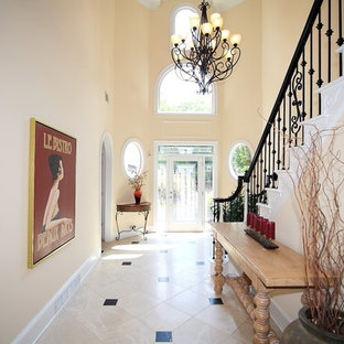 Inspiration for a transitional travertine floor foyer remodel in Atlanta