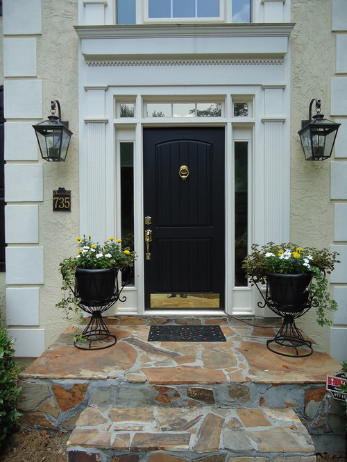 Example Of A Classic Entryway Design In Atlanta With A Black Front Door