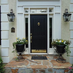 Example of a classic entryway design in Atlanta with a black front door