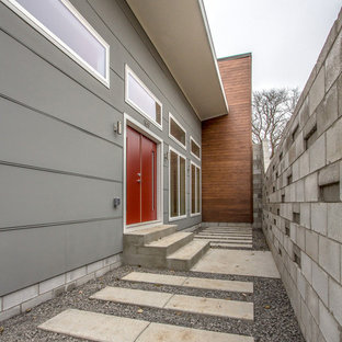 Inspiration for a mid-sized modern entryway remodel in Nashville with gray walls and a red front door
