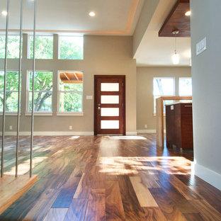 Mid-sized trendy dark wood floor entryway photo in Austin with metallic walls and a dark wood front door