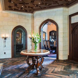 Mid-sized elegant dark wood floor entryway photo in Austin with white walls and a dark wood front door