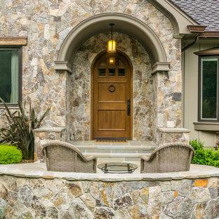 Elegant gray floor entryway photo in San Francisco with gray walls and a medium wood front door