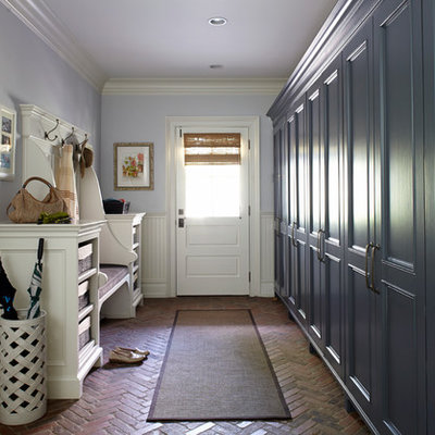Inspiration for a timeless brick floor mudroom remodel in New York