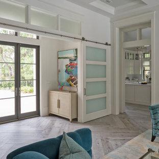 Идея дизайна: фойе в стиле модернизм с белыми стенами, двустворчатой входной дверью, серой входной дверью, серым полом и кессонным потолком