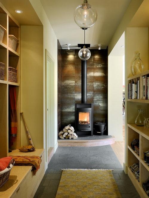 contemporary mudroom idea in burlington with beige walls - Wood Stove Backsplash