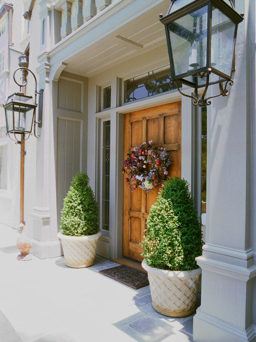 Traditional entryway idea in San Francisco with a medium wood front door