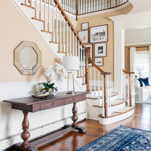 Mid-sized elegant brown floor and dark wood floor foyer photo in New York with beige walls