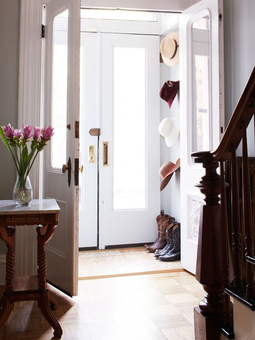 Mid-sized ornate light wood floor entryway photo in New York with gray walls and & Victorian Vestibule with a White Front Door Ideas \u0026 Design Photos ... Pezcame.Com