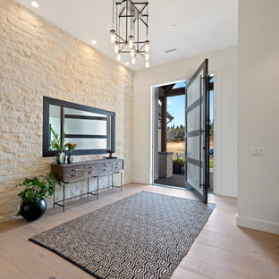 Transitional light wood floor and beige floor entryway photo in Portland with white walls and a black front door