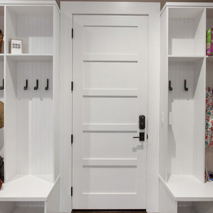 Small farmhouse medium tone wood floor mudroom photo in San Francisco with green walls and a white front door