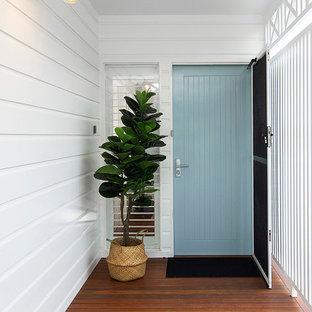 Design ideas for a mid-sized beach style front door in Sunshine Coast with white walls, medium hardwood floors, a single front door, a blue front door and brown floor.