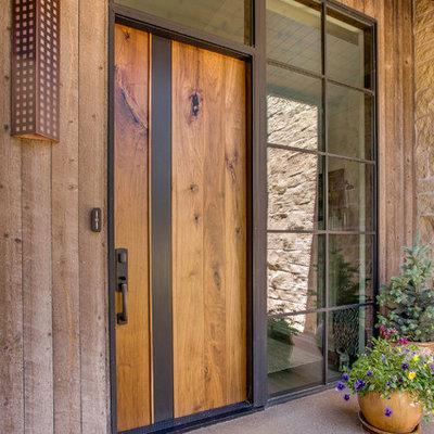 Mid-sized trendy concrete floor entryway photo in Denver with a medium wood front door