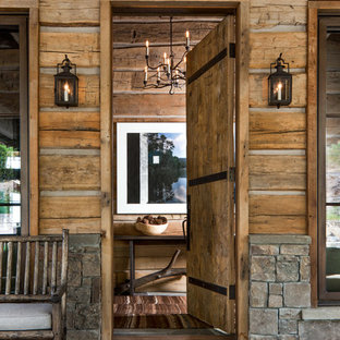 Inspiration for a rustic entryway remodel in Other with a medium wood front door