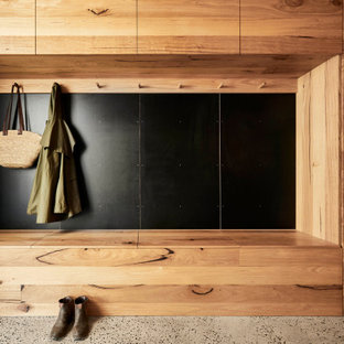 Design ideas for a contemporary mudroom in Geelong with grey floor.