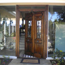 Contemporary Entry by AMIGHINI Antique & Custom Doors