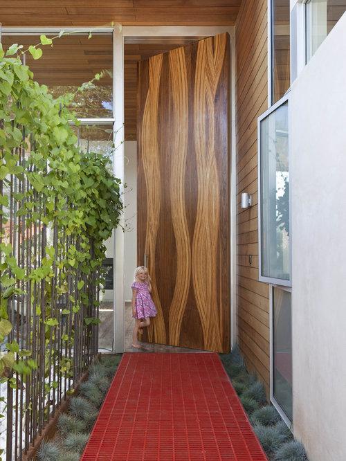 Single front door - huge modern single front door idea in Los Angeles with  a medium