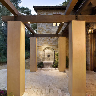 Inspiration for a mediterranean entryway remodel in San Francisco with a dark wood front door