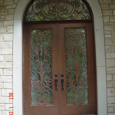 Arch top small Entrance Doors by Arttig - 6 f. x 11 f. powder coated in Copper vain color.