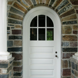 Inspiration for a mid-sized timeless entryway remodel in Other with a white front door