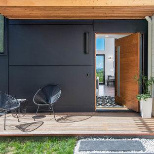 Entryway - scandinavian entryway idea in Other with a medium wood front door