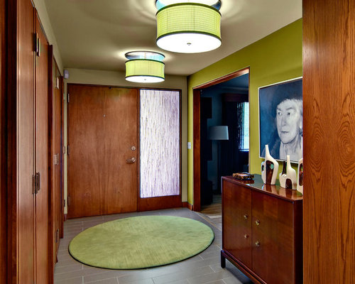 Foto e Idee per Ingressi - ingresso moderno con pareti verdi