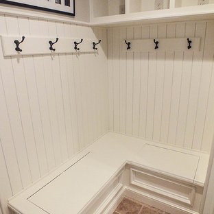 Small elegant ceramic tile entryway photo in Cleveland with white walls
