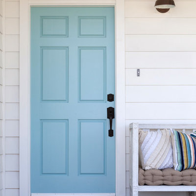 Entryway - large farmhouse entryway idea in Los Angeles with a blue front door