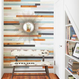 Single front door - contemporary medium tone wood floor single front door idea in Austin with multicolored walls and a white front door