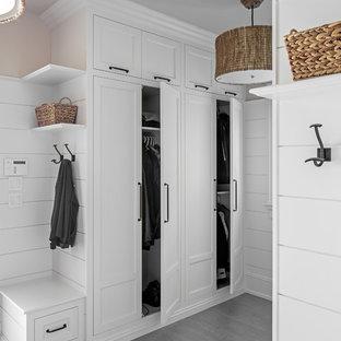 Mudroom - coastal gray floor mudroom idea in Other with white walls