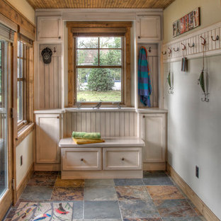 Mid-sized mountain style slate floor and multicolored floor entryway photo in Minneapolis with white walls and a glass front door