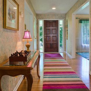 Entryway - eclectic entryway idea in Raleigh with a dark wood front door