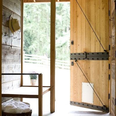 Dutch front door - country dutch front door idea in Seattle with a medium wood front door