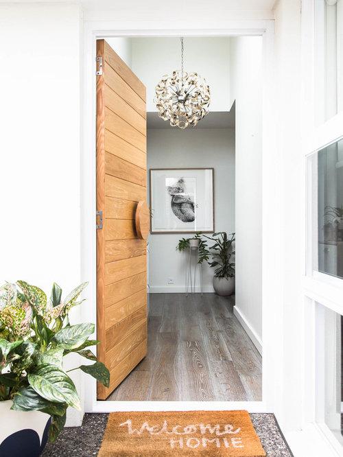 single front door scandinavian single front door idea in melbourne with white walls and a