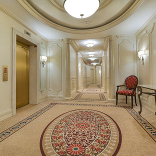 Mid-sized trendy carpeted and beige floor front door photo in Toronto with white walls