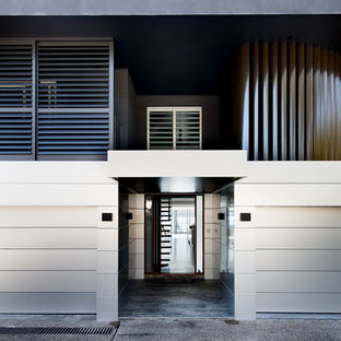 Inspiration for a mid-sized contemporary front door in Sydney with porcelain floors, a double front door, grey floor and white walls.