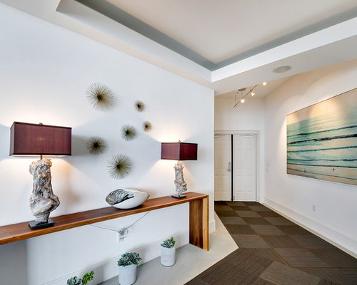 trendy concrete floor entryway photo in miami