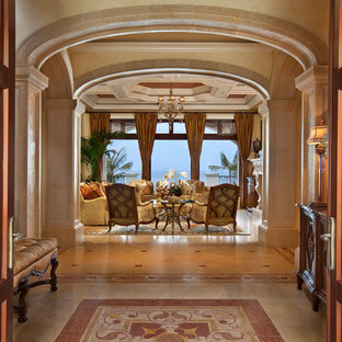Example of a large tuscan entryway design in Miami with a medium wood front door