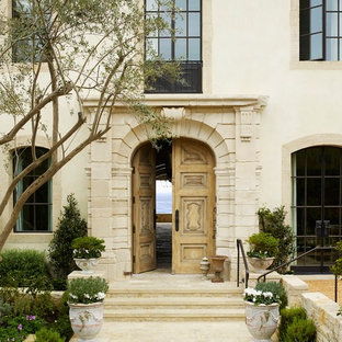 Tuscan entryway photo in Orange County with a light wood front door