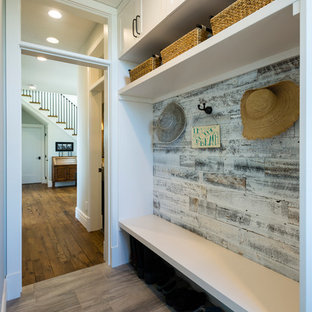 Inspiration for a small coastal porcelain tile and gray floor mudroom remodel in Seattle with white walls