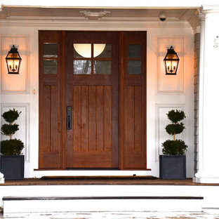 Coastal entryway photo in New York with a dark wood front door