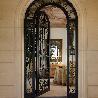 Tuscan entryway photo in Miami with beige walls and a black front door