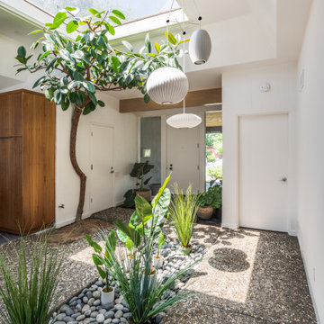 Beautiful Entry With Massive Skylight, Atrium, and Abstract Lantern Pendant Ligh